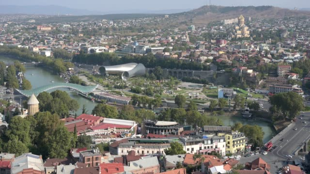 4k aerial shot. building and transport of the old city of tbilisi; georgia. - aerial transport building stock videos & royalty-free footage