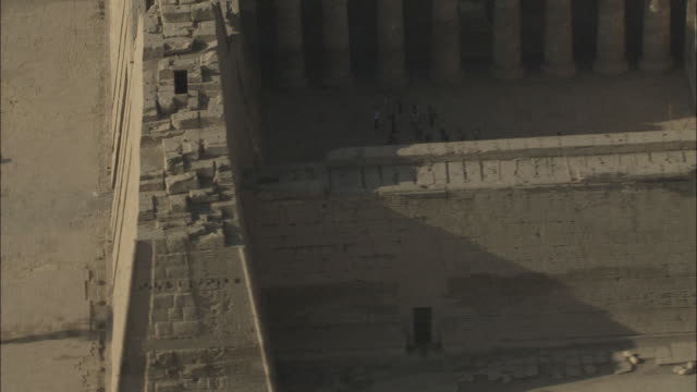 aerial shot circling medinat habu, mortuary temple of ramesses iii - temple building stock videos & royalty-free footage