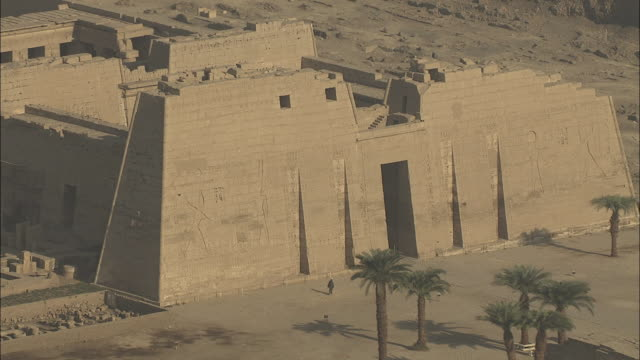 aerial shot circling medinat habu, mortuary temple of ramesses iii - ancient stock videos & royalty-free footage