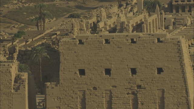 aerial shot circling the karnak temple complex in luxor - temples of karnak stock videos and b-roll footage