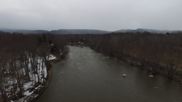 aerial shot descending on river in country during winter - new paltz stock videos and b-roll footage