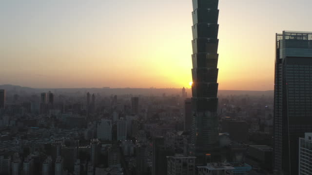 aerial shot downtown taipei, taiwan at sunset - taipei 101 stock videos & royalty-free footage