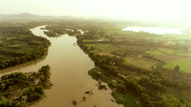 aerial shot drone flow water at the river, in rural countryside areas. - drainage stock videos & royalty-free footage