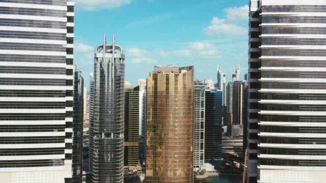aerial shot flying between two skyscrapers, dubai marina, united arab emirates - viewpoint stock videos & royalty-free footage