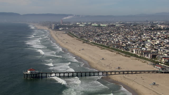 aerial shot flying north along manhattan beach in the south bay region of los angeles county, california. - el segundo stock videos & royalty-free footage