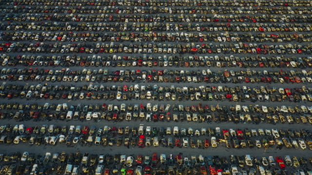 aerial shot flying over a huge vehicle graveyard, el paso, texas, united states of america - scrap yard stock videos & royalty-free footage