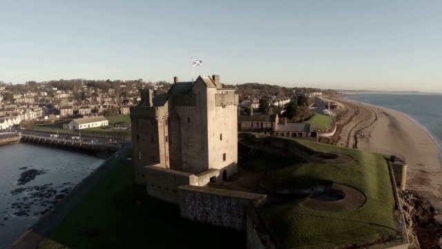 aerial shot flying over broughty castle on the river tay by dundee - dundee scotland stock videos and b-roll footage
