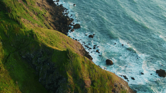 aerial shot flying over edge of cliff and out to sea on the oregon coast - oregon coast stock videos & royalty-free footage