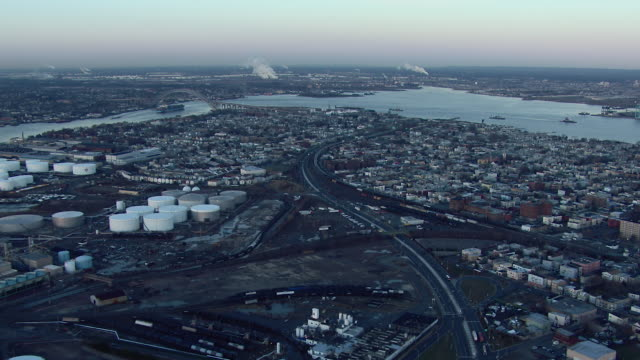 Aerial shot flying over industrial storage tanks in Bayonne, New Jersey.