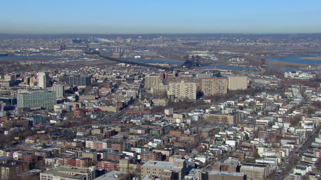 Aerial shot flying over Jersey City, toward the Hackensack River in New Jersey.