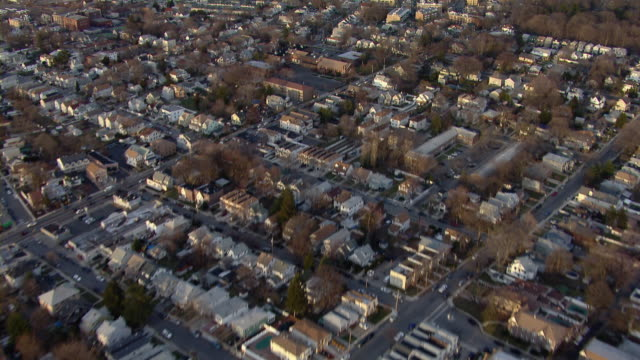 aerial shot flying over residential neighborhoods in staten island, new york city. - staten island stock videos and b-roll footage