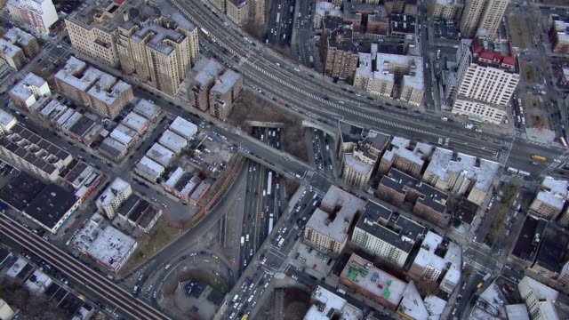 Aerial shot flying over roads and rooftops in West Bronx, New York City.