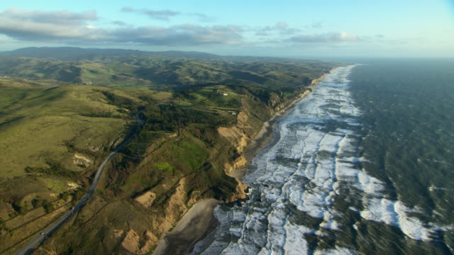 Aerial shot flying over stunning Northern California coastline in San Mateo County.