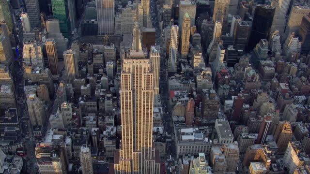 aerial shot flying over the empire state building in manhattan, new york city. - tilt stock videos & royalty-free footage