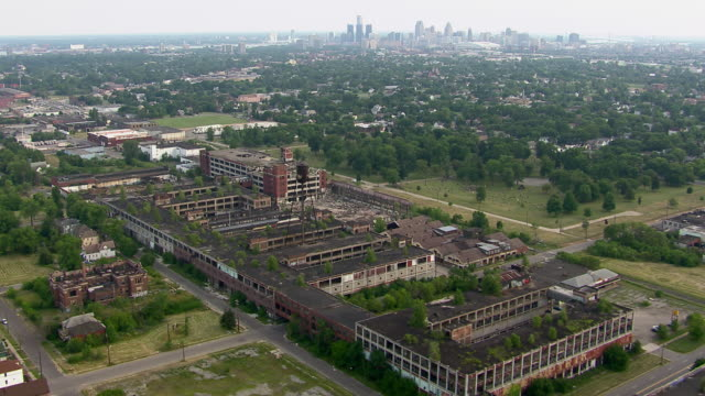 Aerial shot flying over the ruins of the Packard Automotive Plant in Detroit, Michigan.