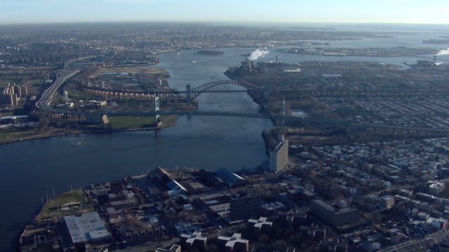 aerial shot flying over the triborough bridge and the hell gate bridge in new york city. - river east stock videos & royalty-free footage