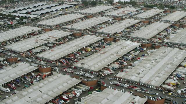 aerial shot flying over wholesale market - central de abastos stock videos & royalty-free footage