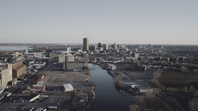 aerial shot flying toward buffalo, new york in winter light - buffalo new york state stock videos & royalty-free footage