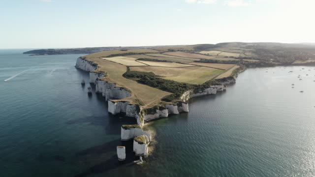 aerial shot flying towards old harry rocks, dorset, england, united kingdom - rock face stock videos & royalty-free footage