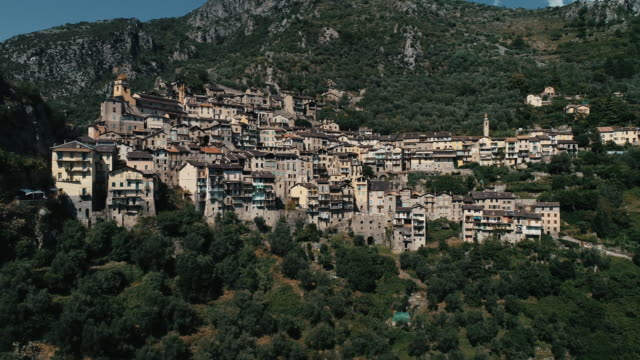 aerial shot flying towards the mountain commune of saorge, france - idyllic stock videos & royalty-free footage