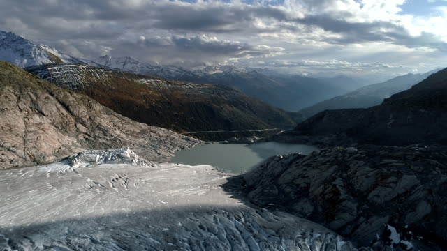 aerial shot flying towards the rhone glacier and surrounding landscape, switzerland - frozen stock videos & royalty-free footage