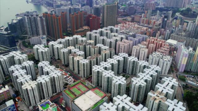 aerial shot flying towards whampoa garden housing estate, kowloon, hong kong - hong kong stock videos & royalty-free footage