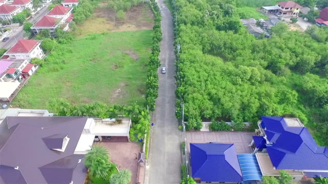 Aerial Shot Follow Car and Community in Thailand