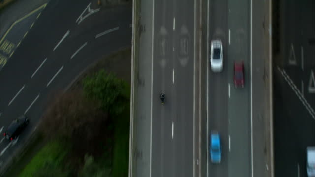 Aerial shot following a scooter driver as they travel along the Westway in West London No core number news rushes lib/aerials tvc westway/1822/9/2