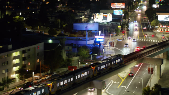 aerial shot following light rail train in west los angeles - train vehicle stock videos & royalty-free footage
