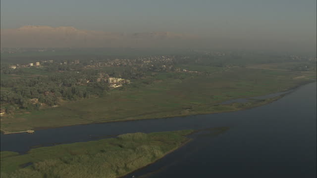 Aerial shot following the banks of the River Nile in Egypt