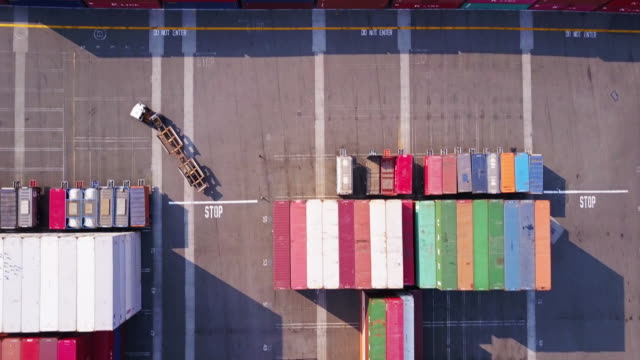 Aerial Shot Following Truck Through Container Yard