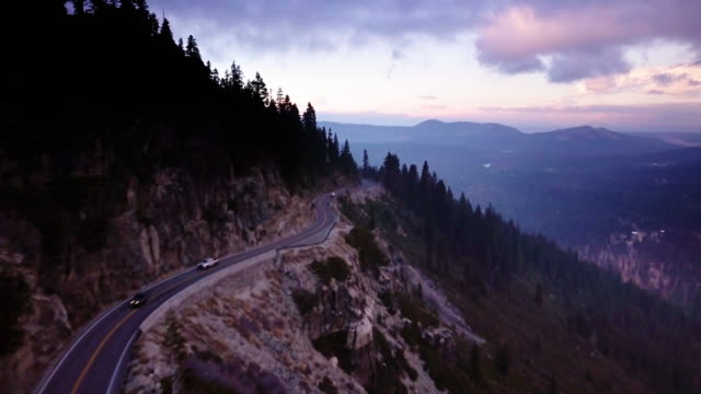 Aerial Shot Following Winding Road Above Valley in California Sierra Nevada