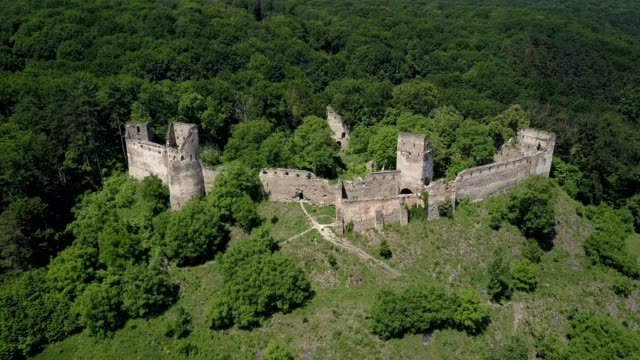 aerial shot from a drone spinning clockwise around the eastern, southern and western sides of the saxon citadel in saschiz, mures county, romania. - mures stock videos and b-roll footage