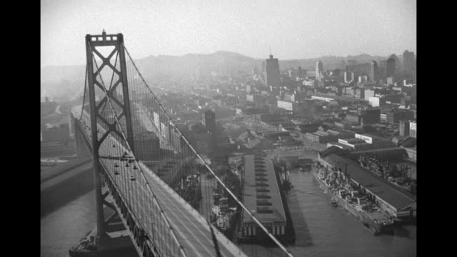 stockvideo's en b-roll-footage met aerial shot from airship of san franciscooakland bay bridge and wharves along shore of city / aerial shot of bridge heading out towards oakland /... - san francisco oakland bay bridge