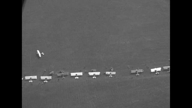 vidéos et rushes de aerial shot from plane of its shadow racing along below / two shots of pilot earl rowland standing in front of his plane posing for photo opportunity... - ohio