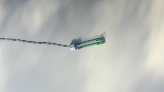 vidéos et rushes de aerial shot hovering above a dredger in a lake, france - eco tourism