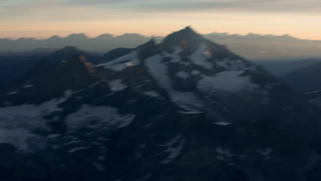 aerial shot hovering next to a snow and ice-covered mountain in the swiss alps. - helicopter point of view stock videos & royalty-free footage