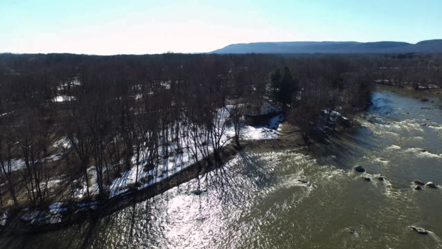 aerial shot hovering over a river with water moving fast over rocks - new paltz stock videos and b-roll footage