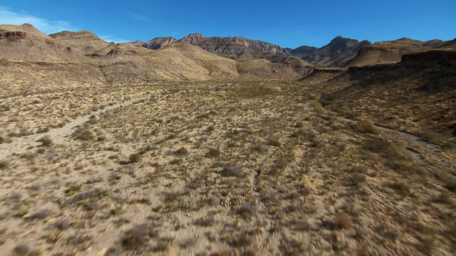 stockvideo's en b-roll-footage met aerial shot in big bend national park flying over homer wilson ranch house into blue creek canyon. - ranch