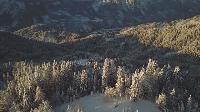 aerial shot in winter in alps over mountain huts - slovenia stock videos & royalty-free footage