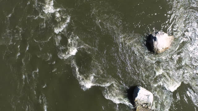 aerial shot looking directly down at water flowing over rocks in river - new paltz stock videos and b-roll footage