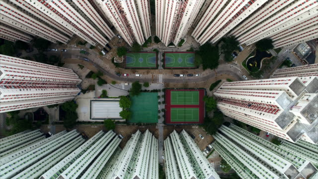 aerial shot looking directly down over richland gardens housing complex, kowloon, hong kong - diminishing perspective stock videos & royalty-free footage