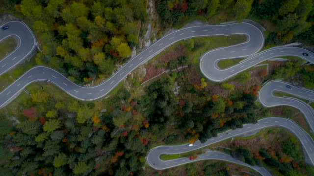 aerial shot looking down and moving forward over the maloja pass, switzerland - squiggle stock videos & royalty-free footage