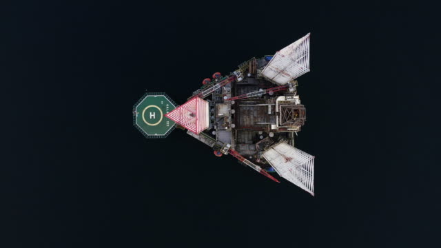 aerial shot looking down and moving up showing an oil platform in a sea channel, cromarty firth, scotland, united kingdom - construction machinery stock videos & royalty-free footage