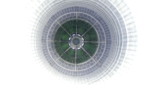 vidéos et rushes de aerial shot looking down and rotating 360 degree above an abandoned cooling tower, charleroi, belgium - ingénierie