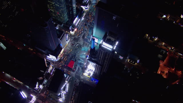 Aerial shot looking down at Times Square in New York City at night.