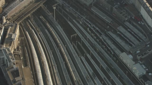 vidéos et rushes de aerial shot looking down at trains and train tracks in paris france, daytime - chemin de fer