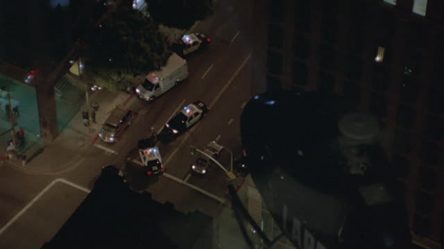 Aerial. shot looking down from helicopter with spotlight on police scene.