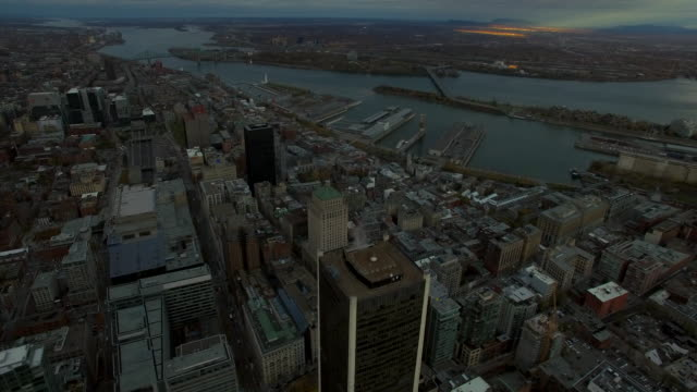 Aerial shot looking down on city to tilt up and revel city scape of Montreal.