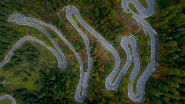 aerial shot looking down on maloja pass during autumn, switzerland - kringel stock-videos und b-roll-filmmaterial